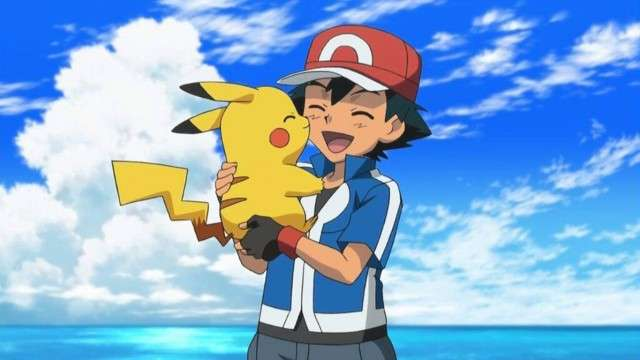 Ash holding pikachu and smiling